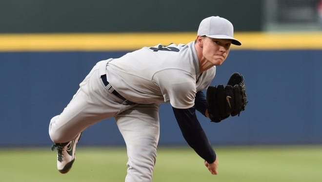 Oakland pitcher Sonny Gray (54) pitches against Atlanta during the first inning at Turner Field in Atlanta on Saturday.