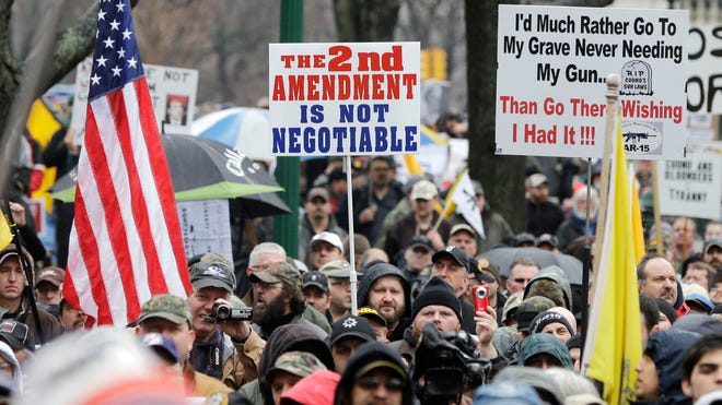 Gun-rights advocates demonstrate outside the Capitol in Albany in 2013. The group rallied against the recently legislated New York SAFE Act and other measures they say infringe on their constitutional right to bear arms.