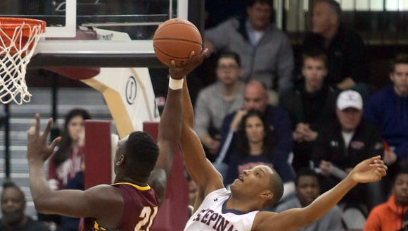 Joel Soriano of Stepinac blocks a shot by Christ the