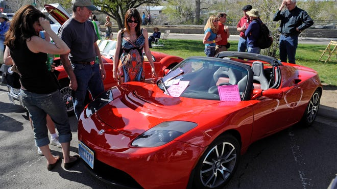 An all-electric Tesla Roadster was a popular attraction at the Earth Day celebration at Idlewild Park in 2010.