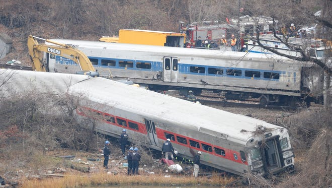 A rail crew works at the scene of the fatal Metro-North train derailment on December 2, 2013 in the Bronx near the Spuyten Duyvil station. The Metro-North passenger train derailed en route to New York City near the Spuyten Duyvil station, killing four people and wounding more than 70 others on December 1, 2013.