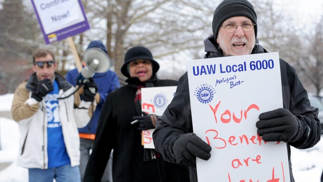 This 2013 State Journal file photo shows state employees protesting in downtown Lansing amid contract talks.