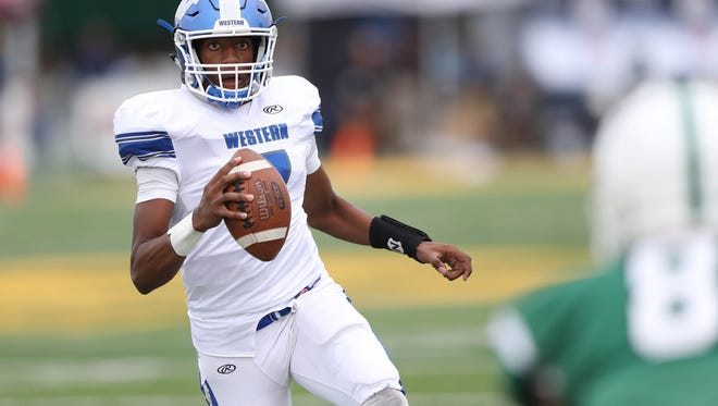 Walled Lake Western's Sam Johnson runs the ball during the second half of Western's 19-14 win over West Bloomfield on Thursday, Aug. 24, 2017, at Comerica Park.