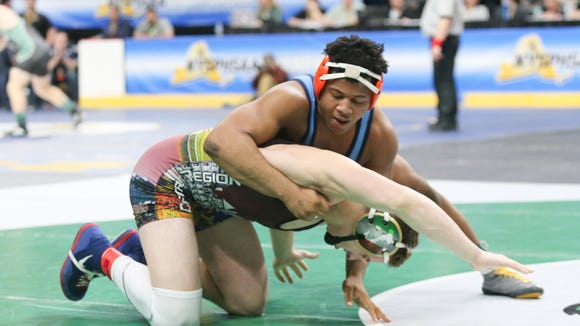 East Ramapo's Jhordyn Innocent in the 195-pound quarterfinal match of the NYSPHSAA Wrestling Championships at Times Union Center in Albany on Friday, February 23, 2018.