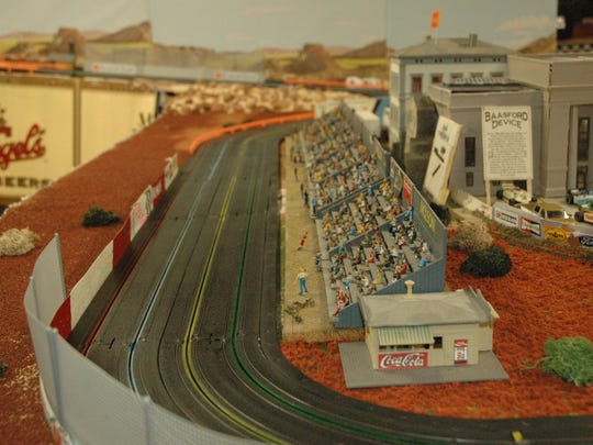 The Wauwatosa Indy Slot Car League is celebrating their 25th year. Each member has a theme for their racing track. This track was inspired by New Mexico.