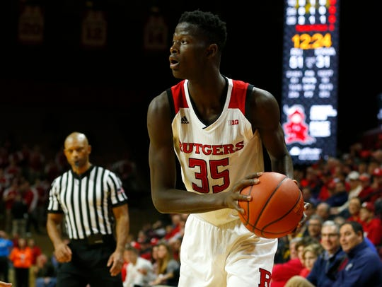 Rutgers Scarlet Knights guard Issa Thiam (35) looks