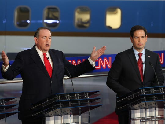 Mike Huckabee and Marco Rubio take part in the presidential