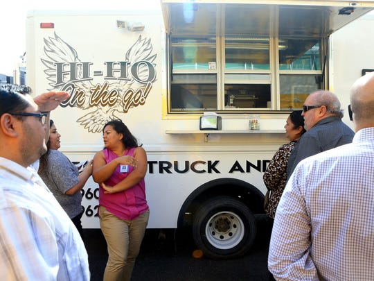 Customers wait for their meals at the Hi-Ho food truck in December at the RTA bus station in Corpus Christi.