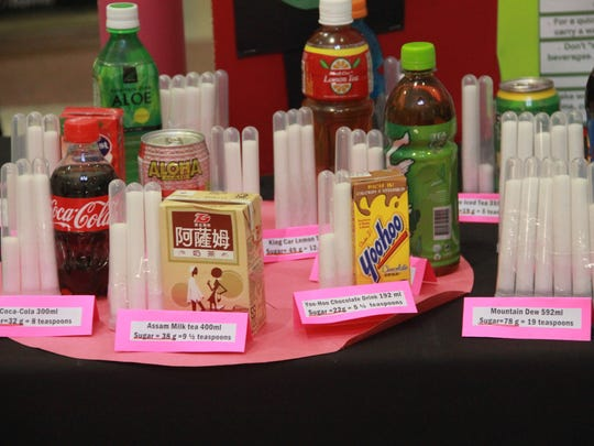 A Guam Memorial Hospital display shows the amounts of sugar contained in popular sweetened beverages. The display was in support of the release of the 2016-2020 strategic plan for diabetes prevention and control in Guam on March 25.