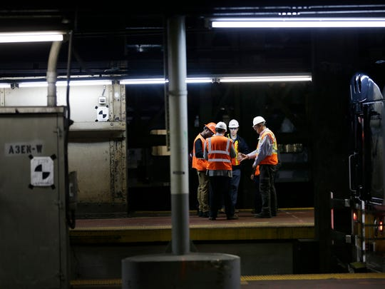 Maintenance workers on a platform in Penn Station in New York in May.
