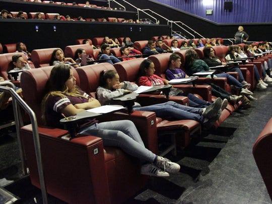 Eighth-grade students learn about Tulare Joint Union High School District's Career Pathways programs at Galaxy Theater Tulare on Thursday morning.