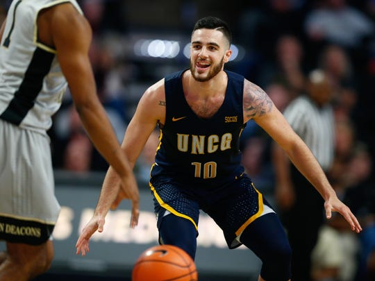 Nov 24, 2017; Winston-Salem, NC, USA; UNC-Greensboro Spartans guard Francis Alonso (10) smiles after making a three point basket in the second half against the Wake Forest Demon Deacons at Lawrence Joel Veterans Memorial Coliseum. Mandatory Credit: Jeremy Brevard-USA TODAY Sports