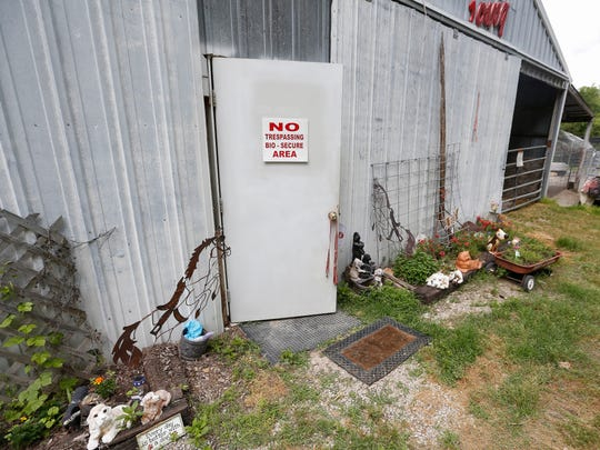 The entrance to the barn where Ann Quinn breeds her dogs in Niangua has a sign on the door noting that it is a bio-secure area.