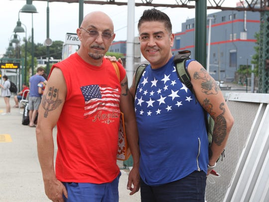 Fabio Cotza, left, and his husband, Hector, on their