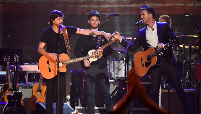 Chris Janson and Jake Owen perform with Ben Haggard at the Merle Haggard tribute concert on Thursday, April 6, 2017, at Bridgestone Arena in Nashville.