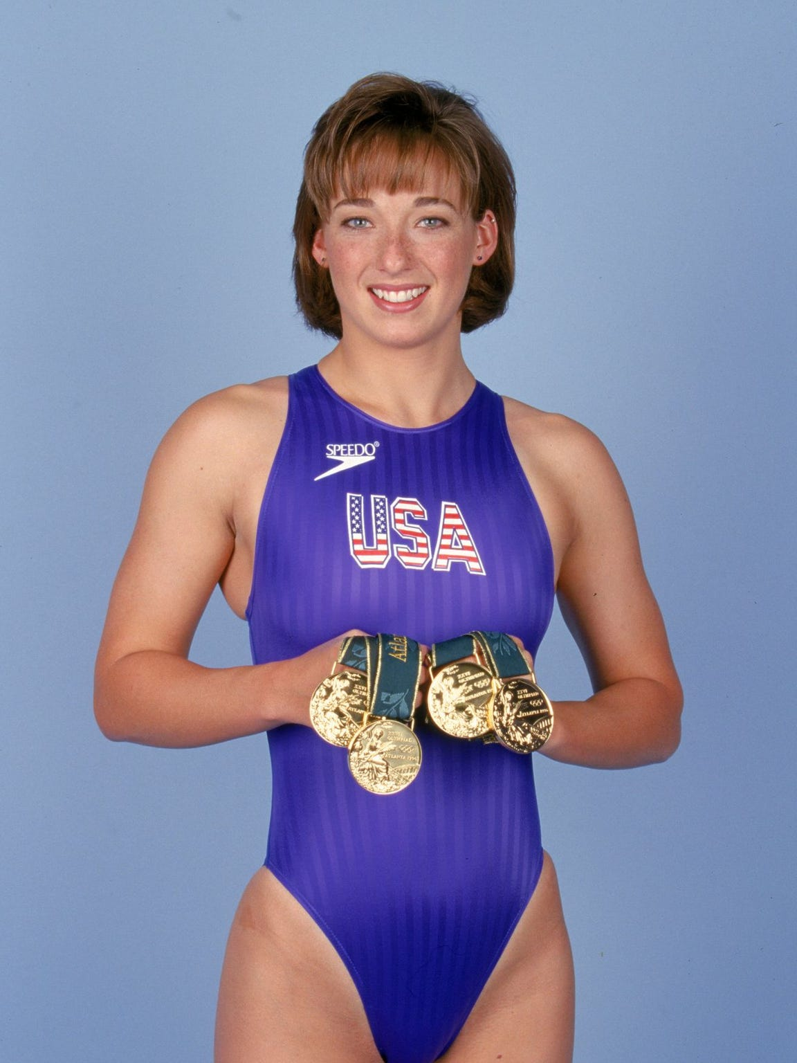 Proving it: Amy Van Dyken with her golds in 1996.