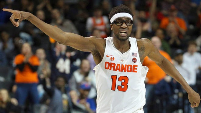 """Syracuse and junior center Paschal Chukwu (13) seemed pointed in the wrong direction down the stretching, losing four of their last six games, but the Orange slid into the NCAA Tournament and play a """"First Four"""" game on Wednesday in Dayton, Ohio vs. Arizona State."""