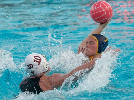 La Quinta High School's Lauren Olivier tries to score
