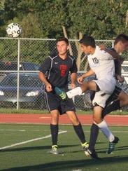 Stevenson's Joe Nicolas clears the ball as Frankln's