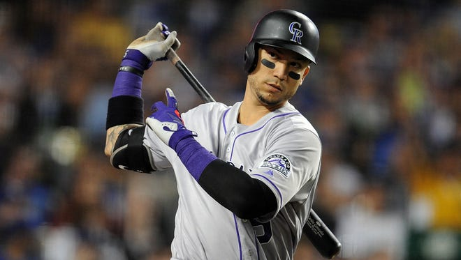 """We're not coming here to try to take anybody's food away but to provide better opportunities for our kids,"" Rockies outfielder Carlos Gonzalez says of immigrants from Latin America."