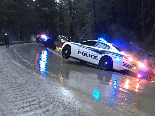 Watch police SUV slide on icy road into woods