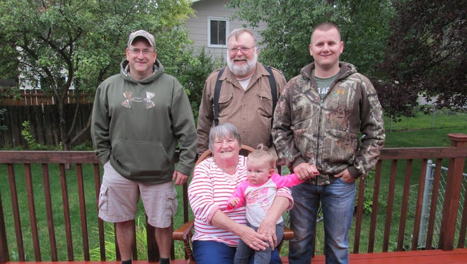 Seated in the center is Viola Allestad holding her great-great-granddaughter Caroline Allestad. Behind Viola, from left to right, are her grandson Grant Allestad, son Ole Allestad and great-grandson Joshua Allestad.