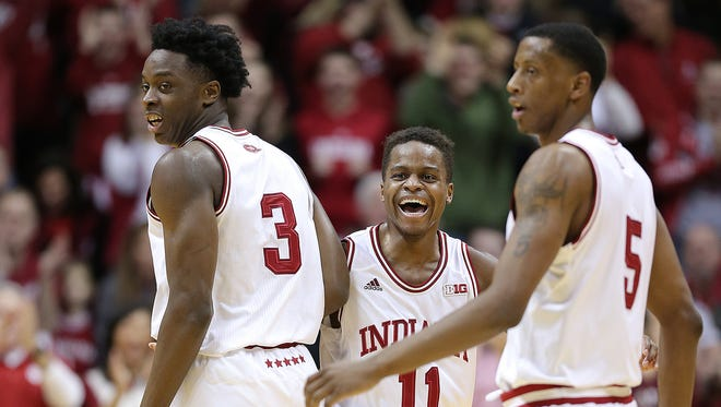 Hoosiers guard Yogi Ferrell (11) celebrates with OG Anunoby (3) and Troy Williams (5) during IU's 85-60 win over Ohio State on Sunday.