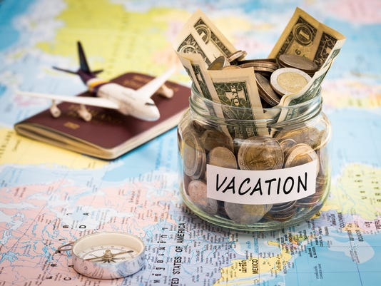 Vacation budget concept with compass, passport and aircraft toy