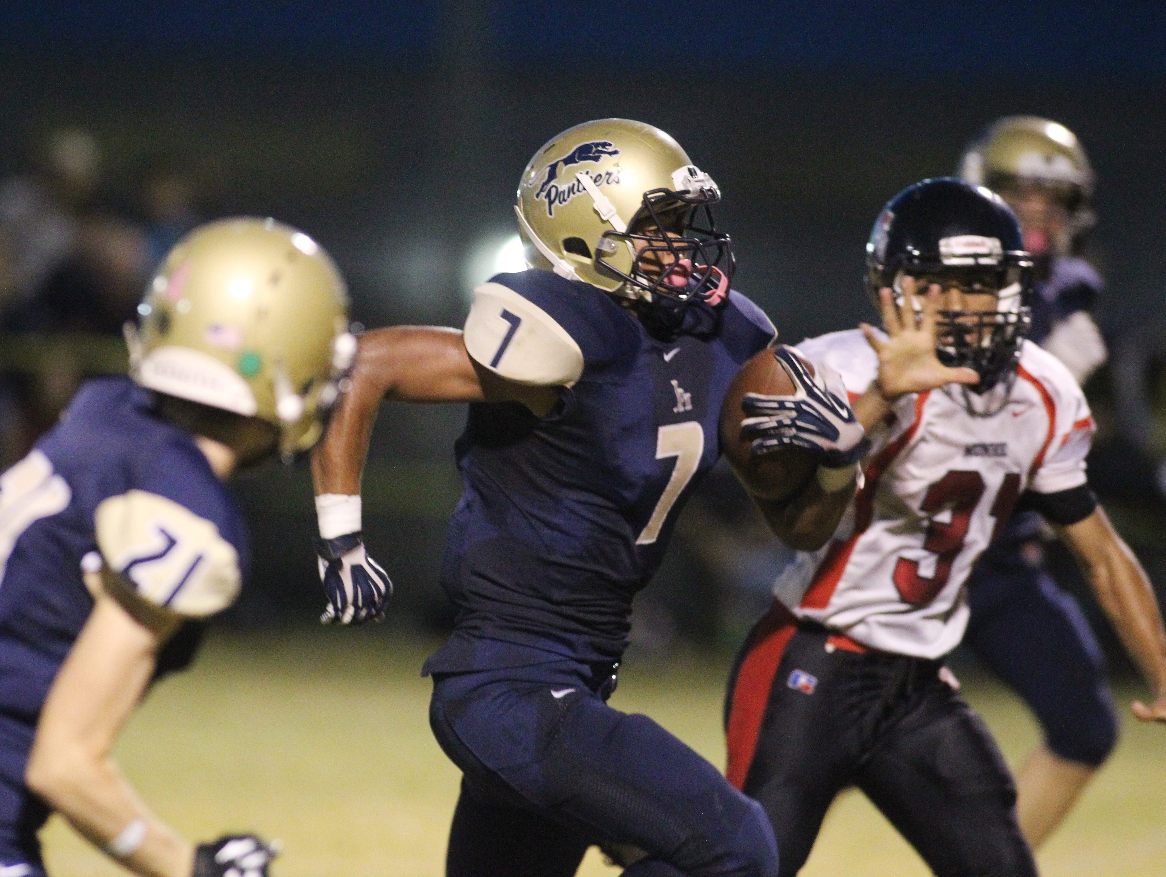 John Paul II wide receiver Sam Smith sprints toward the end zone in a game against Munroe.