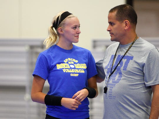 Former Burris volleyball coach John Rodriguez works with a player during a 2013 practice. Rodriguez resigned after two seasons with the Owls.
