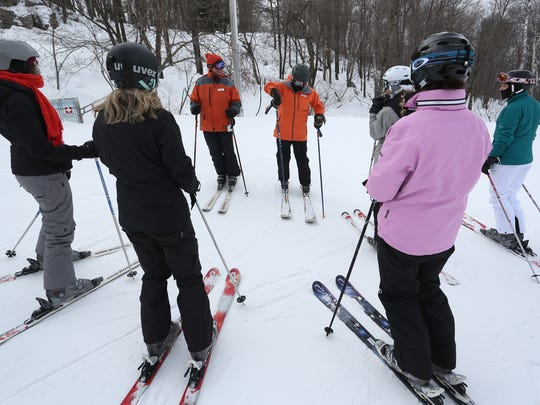 Brenda Zimmermann Thorpe, center right, gestures Wednesday as she instructs one of the Granite Peak Ski Area's Women's Turn ski clinic groups at the top of a run. Daily Herald Media reporter Nora Hertel, far left, is part of the group.