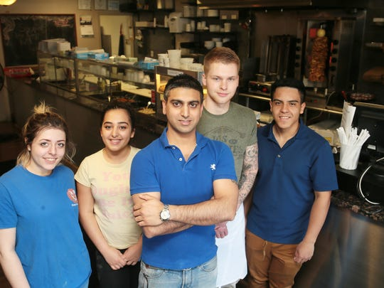 Owner Kartikeya Kathpalia of Edison, center, at Crazy 4 Falafel restaurant in Edison on April 14, 2016. with staff, from left, Rebecca Shaferman of Edison, Aaliyah Ghanim, of North Plainfield, manager Michael Huberof South Plainfield, and Efren Correa of South Plainfield. Not pictured, Kunal Kathpalia, co-owner and brother of Kartikeya Kathpalia. (Keith Muccilli/ Staff photographer)
