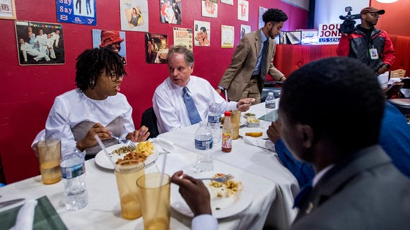 U.S. Senate candidate Doug Jones eats lunch with Alabama State University students at Touch of Soul Cafe in Montgomery, Ala. on Wednesday November 8, 2017.