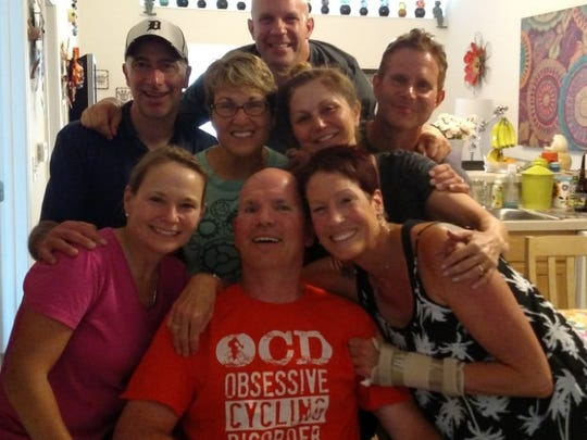 John Fenlon (front row, middle) is surrounded by family and friends during a recent get-together in his Howell home.