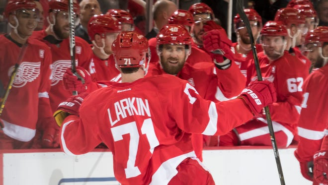 Detroit center Dylan Larkin celebrates with his teammates after scoring in the first period.