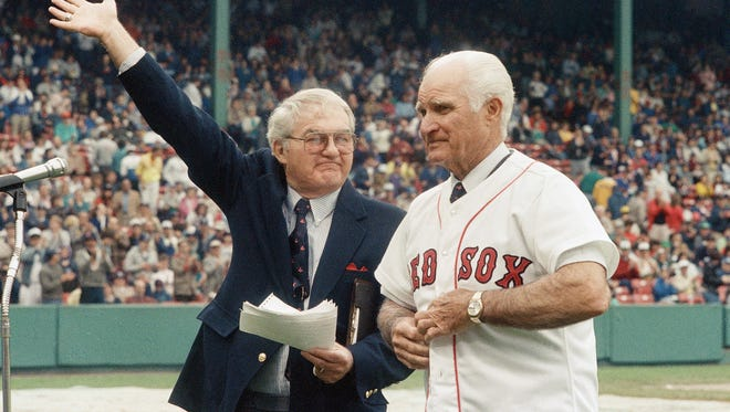In this May 21, 1988, file photo, the radio voice of the Boston Red Sox, Kent Coleman, left, presents former Red Sox second baseman Bobby Doerr to the crowd at Fenway Park during a ceremony to retire his number 1.