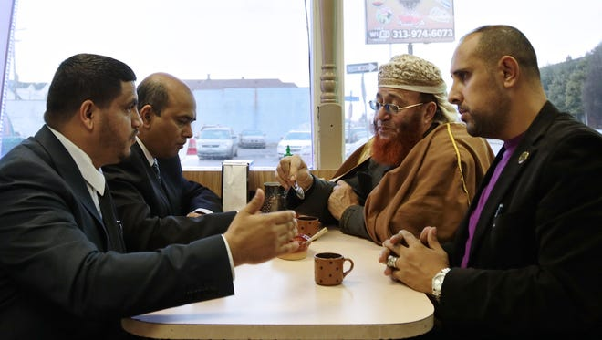 From left, city councilman Saad Almasmari, 28, of Hamtramck, city councilman Mohammad Hassan, 49, of Hamtramck, Imam Abdou Alwaly Zindani, and campaign manger Ibrahim Aljahim, 33, of Hamtramck, talk over a cup of coffee at Mocha Cafe in December 2015, in Hamtramck.