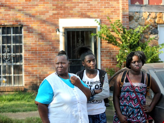 September 28, 2016 - Cassandra Bray (left) stands outside her Frayser home with her granddaughters Parish Bray and Parionna Bray. Their apartment has mold in various rooms, roach infestation and rat holes. Earlier this year a family member was hospitalized with asthma complications.