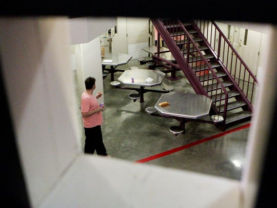 An inmate walks out to the day area in the Shasta County