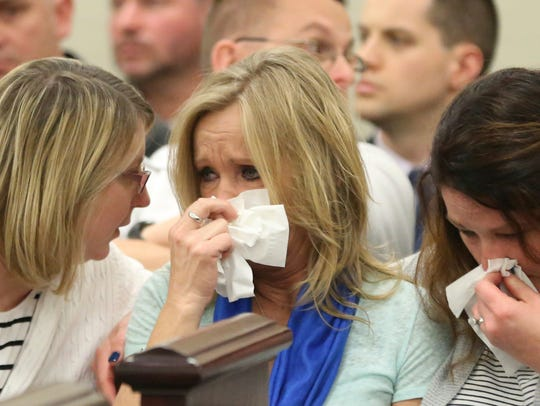Tammy Weeks, center, mother of victim Nicole Lovell,
