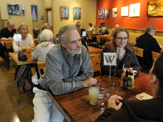 Green Sage owner Randy Talley talks with customers at the restaurant's South Asheville location in 2011.