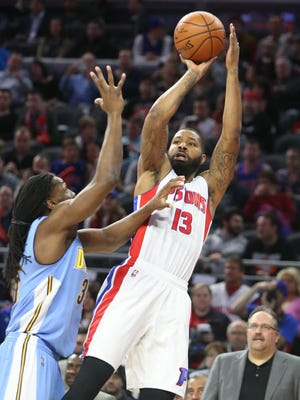 Pistons forward Marcus Morris scores on Nuggets forward Kenneth Faried Wednesday at the Palace.