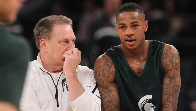 Michigan State Spartans head coach Tom Izzo talks with guard Keith Appling (11) during practice for the east regional of the 2014 NCAA Tournament at Madison Square Garden.