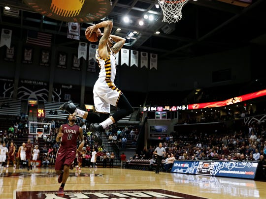 Missouri State Bears forward Chris Kendrix (33) dunks the ball after a fast break during second half action of the Bears' game against the IUPUI Jaguars at JQH Arena in Springfield, Mo. on Dec. 10, 2015. The Bears won the game 88-74.
