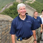 Gov. Rick Snyder climbs the Great Wall of China in Mutianyu with David Lorenz, vice president of the Michigan Economic Development Corporation for Travel Michigan. The Michigan delegation was at the Great Wall to talk about tourism opportunities in Michigan, part of an eight-day trade mission to boost ties and economic development.
