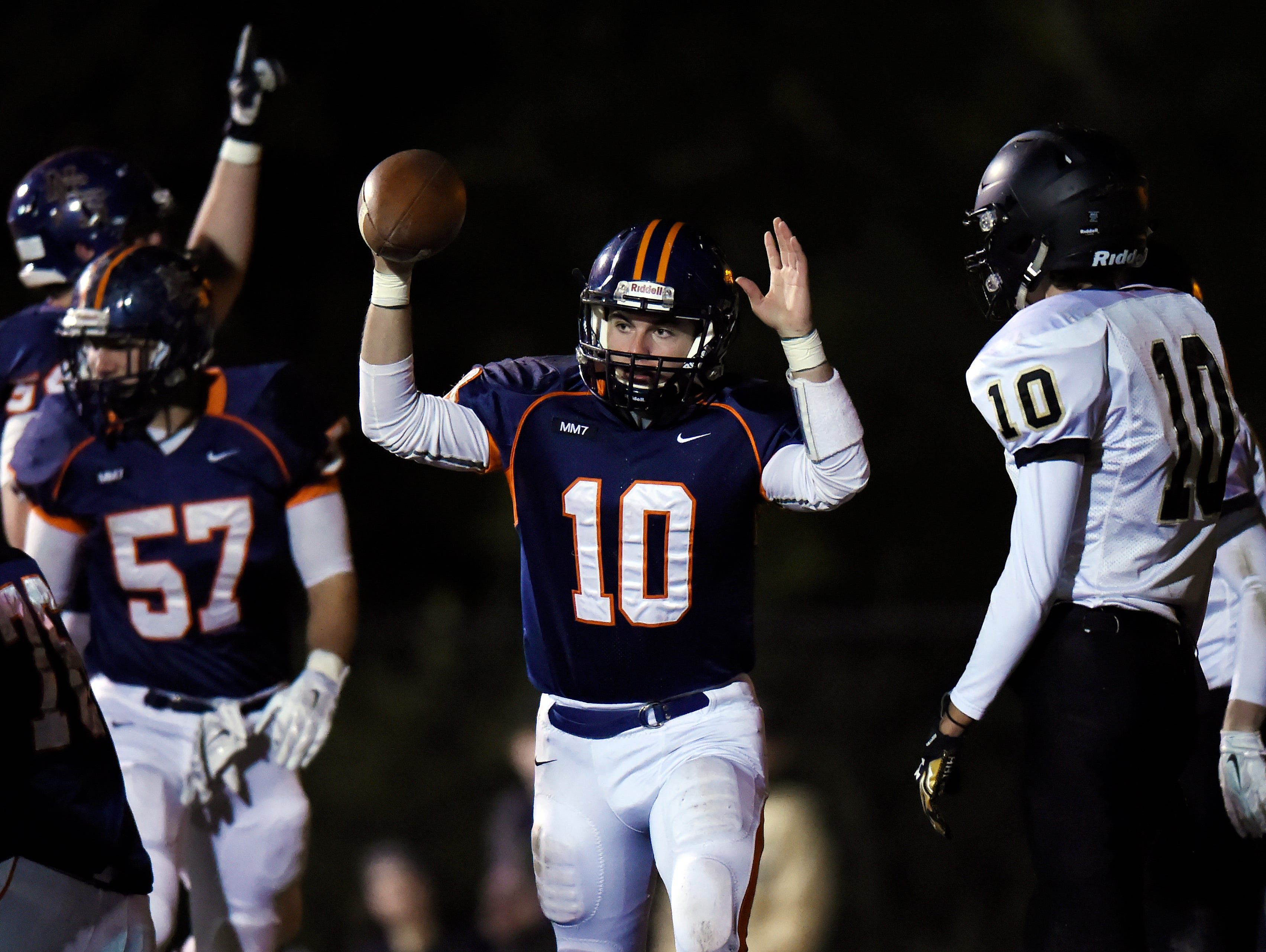 Nashville Christian quarterback Kyle Tidwell (10) celebrates after scoring on a 1-yard touchdown run in the first half of an 1A quarterfinal playoff football game against Wayne County at Nashville Christian High School on Friday, Nov. 20, 2015 in Nashville, Tenn.