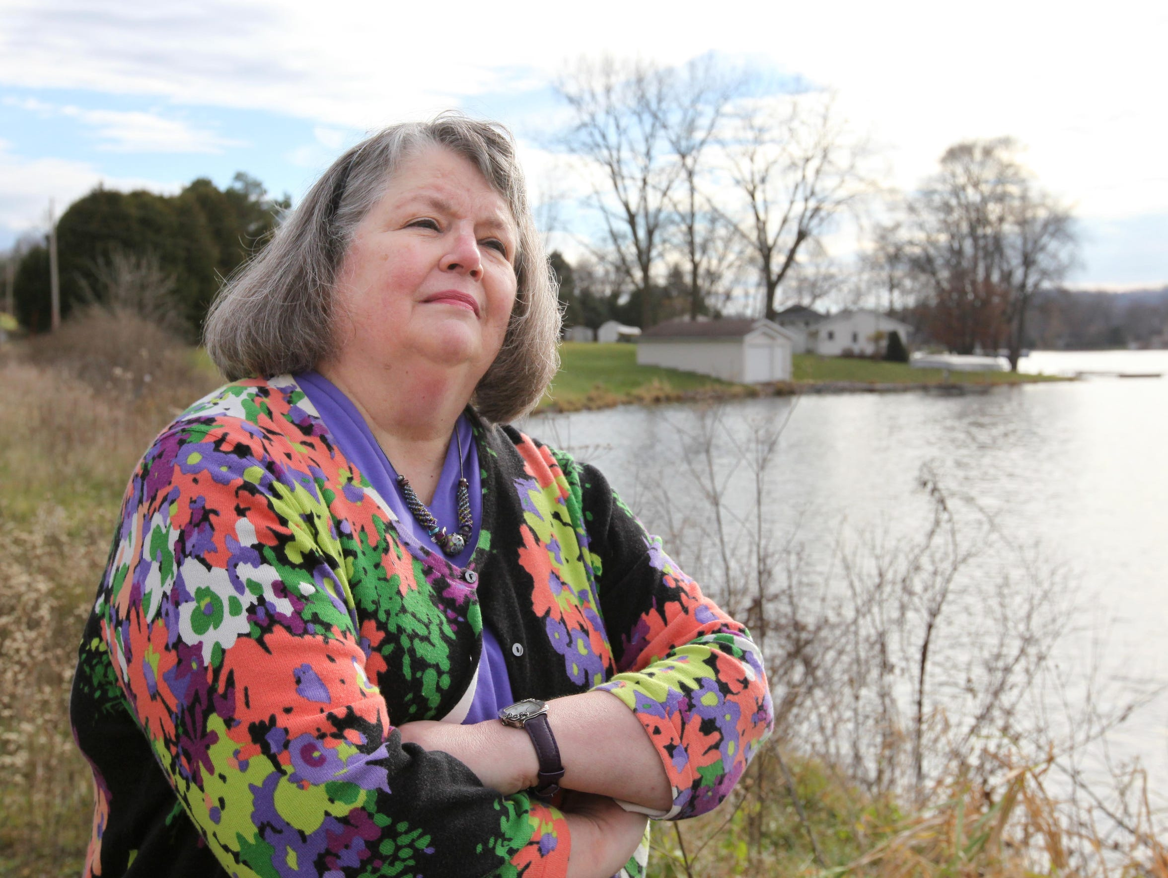 Mary Jane Koch stands near the site of her family's