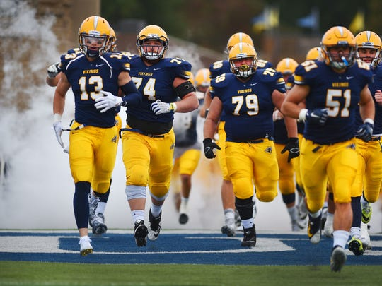 Augustana players take the field to play Wayne State College Saturday, Sept. 30, at Kirkeby-Over Stadium in Sioux Falls.