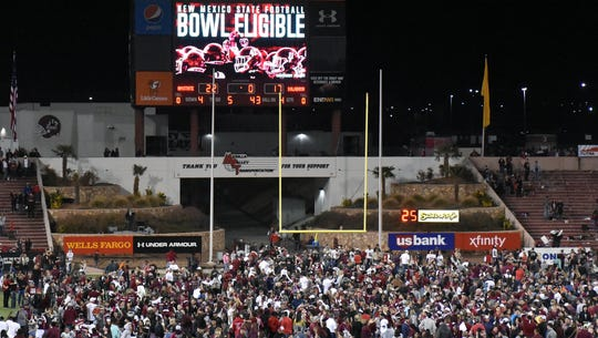 Fans rushed onto the field after the Aggies won and
