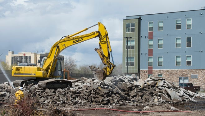 Construction begins on a parking garage to accommodate residents of The Summit on College Tuesday, April 12, 2016. The student housing project experienced issues with overflow parking after opening more than two years ago.